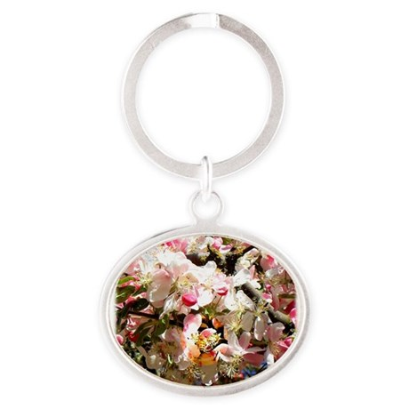 What spring does to cherry trees Oval Keychain