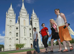 SALT LAKE CITY - JULY 12:  Protesters walk past the Mormon Temple on the Main Street Plaza holding hands July 12, 2009 in Salt Lake City, Utah. The protesters defied church security warnings and walked onto the plaza anyway to protest the detention and handcuffing of two gay men for holding hands and one kissing the other on the cheek there on July 9. The men were also sited by the Salt Lake City police.  (Photo by George Frey/Getty Images)