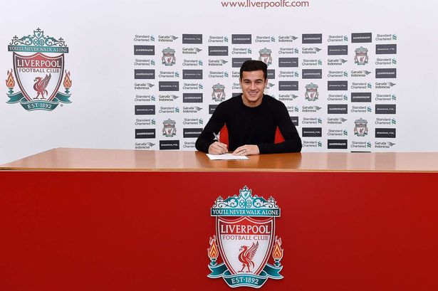 Image result for Philippe coutinho signing a contract with Liverpool