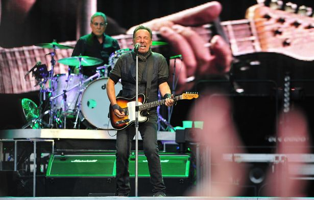 Bruce Springsteen performing at the Etihad Stadium