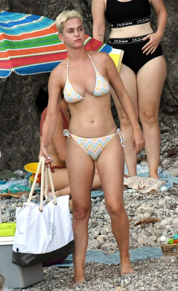Katy Perry looked every inch the pop vixen as she slipped into a tiny two piece for a spot of sunbathing on the sand in Italy, on Sunday (Image: CAPR)