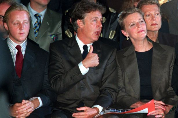 Paul McCartney sits between his son James and former wife Linda