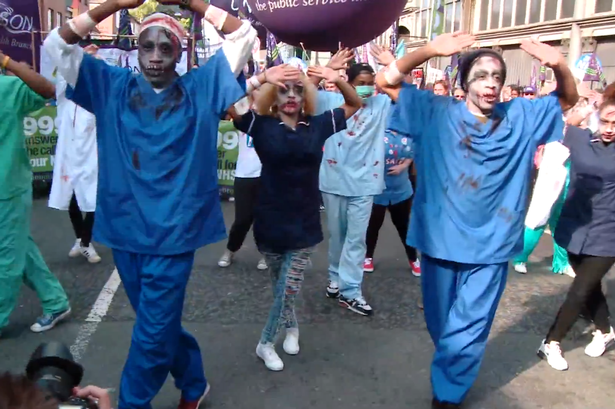Killing the NHS: Zombie doctors and nurses dance