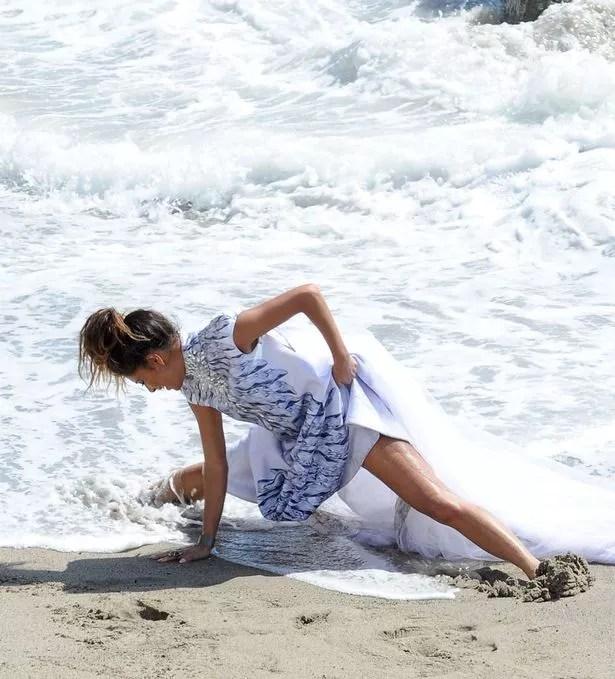 Nicole Scherzinger Frolics Around White Sandy Beach As She