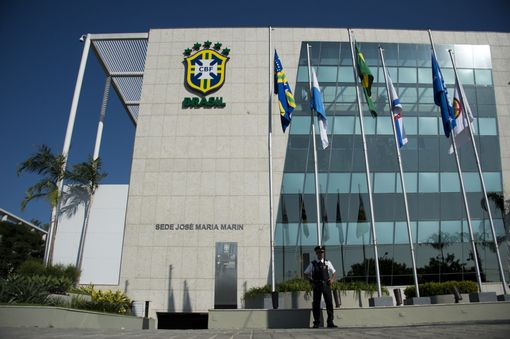 A police officer stands guard outside the headquarters of the Brazilian Football Confederation