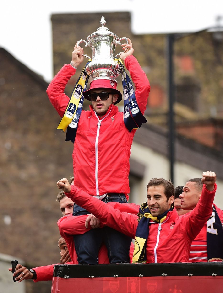 Jack Wilshere holds the trophy