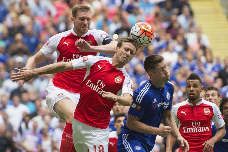 Nacho Monreal clears from Gary Cahill