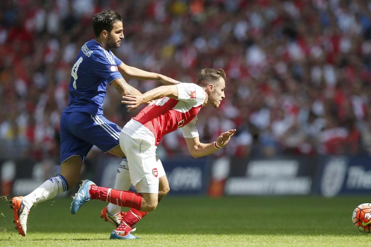 Cesc Fabregas challenges Aaron Ramsey