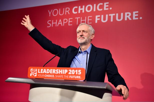 New Labour leader Jeremy Corbyn waves to the conference