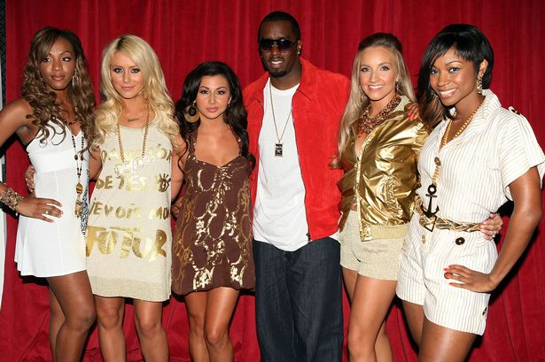 "Sean ""P. Diddy"" Combs poses with Danity Kane"