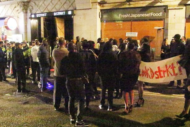 General views of crowds gathering in protest outside DSTRKT nightclub in London