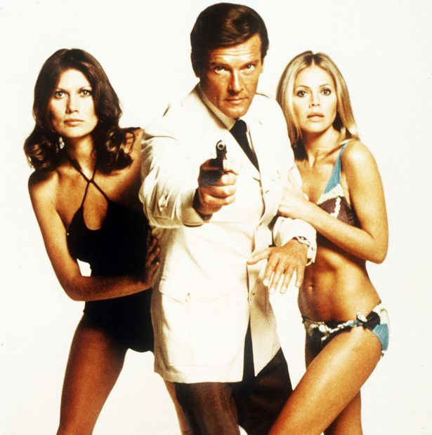 Roger-Moore-as-James-Bond-007-with-Britt-Ekland-and-Maud-Adams-in-The-Man-with-the-Golden-Gun James Bond director who helmed four 007 movies dies at 93