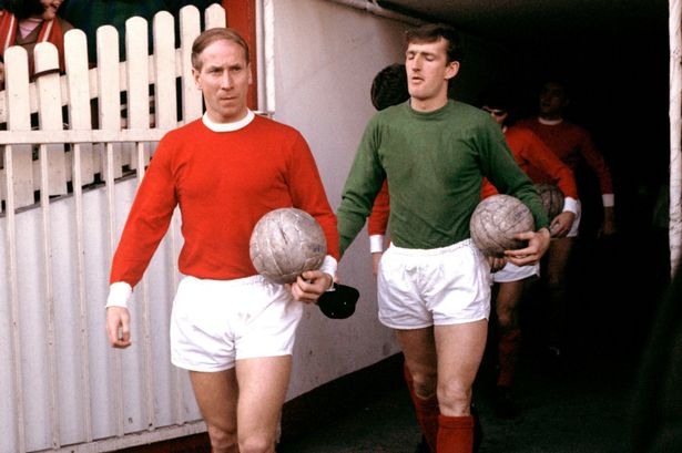 Manchester United's Bobby Charlton and Alex Stepney walk out onto the pitch before the match in 1969