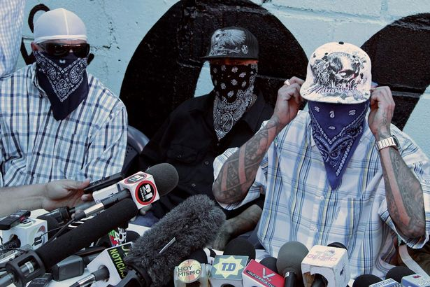 Members of the Mara Salvatrucha (MS-13) gang, offer a press conference at a prison in San Pedro Sula, 240 km north of Tegucigalpa, on May 28, 2013.