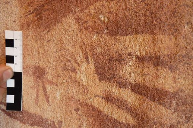 The walls of Wadi Sura II are covered with hundreds of hand stencils, as well as images of people, wild animals and unusual headless beasts