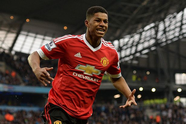 Marcus Rashford celebrates scoring the first goal
