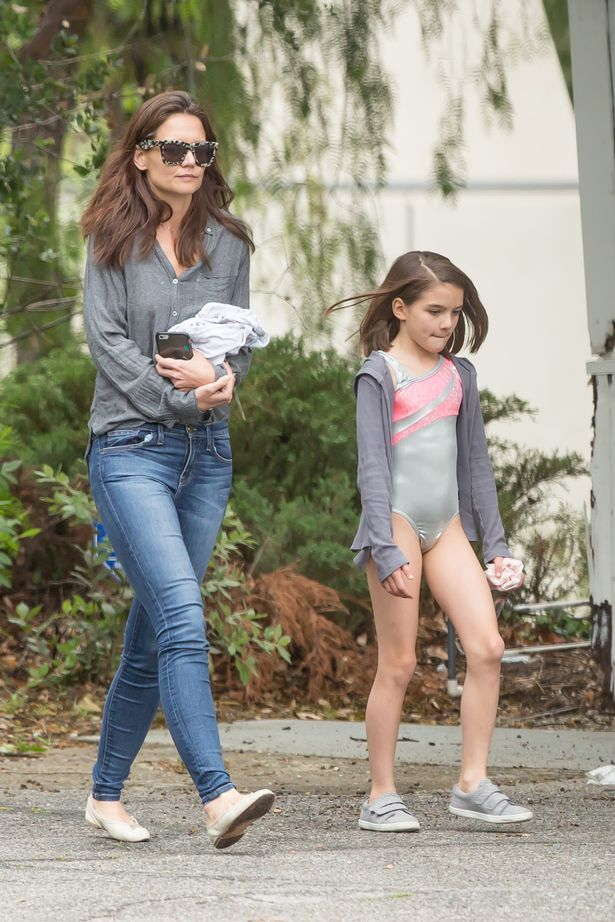 Suri Cruise looked like a perfect doll as she walked out of dance class with her famous mom, Katie Holmes