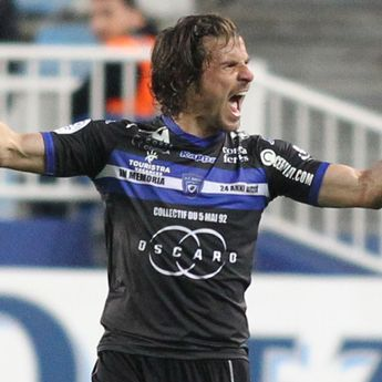 Yannick Cahuzac celebrates after scoring during the L1 football match between Bastia and SCO Angers on May 7, 2016