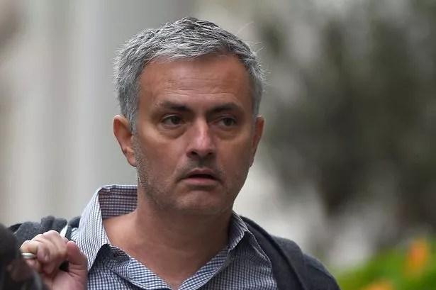 Jose Mourinho walks towards his house in London, May 25, 2016