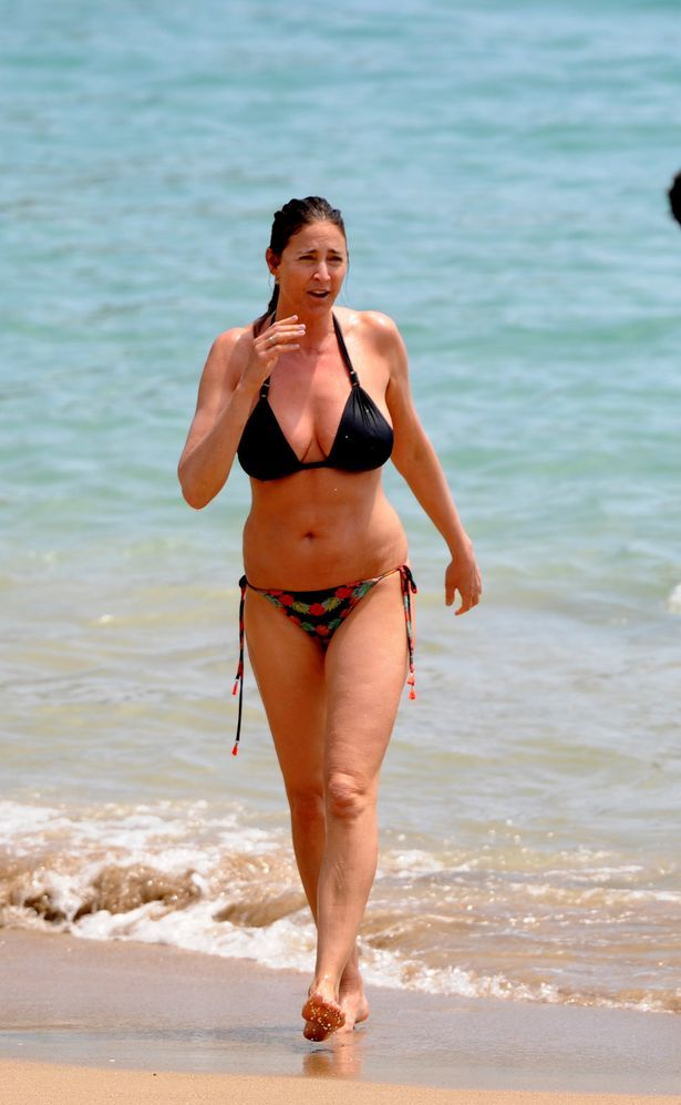 Lisa Snowdon ensures an all over tan as she goes topless on beach in Ibiza, Spain