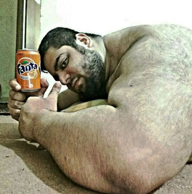 The weightlifter likes to take pictures with objects that look smaller when held next to him