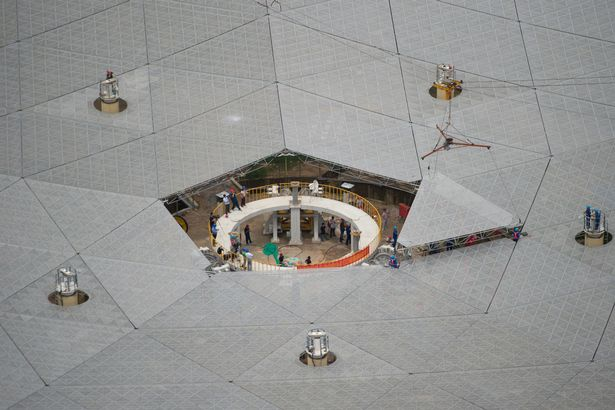 The last triangular panel to the reflector of Aperture Spherical Telescope is being installe