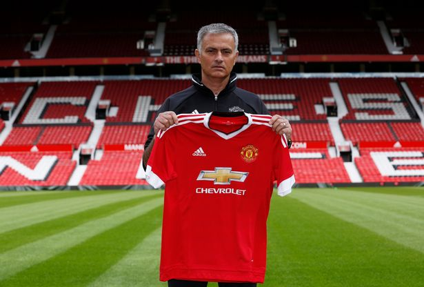 Jose Mourinho poses ahead of the press conference