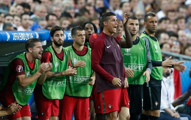 Cristiano Ronaldo watches from the bench during extra time