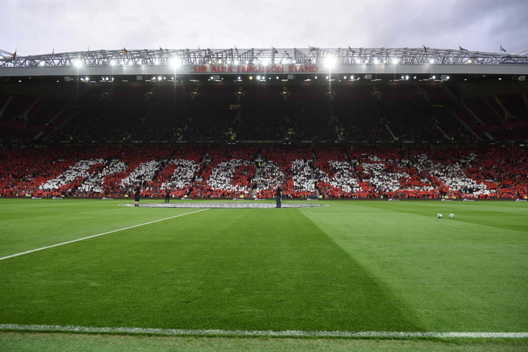 Fans in the stands spell out the name of Wayne Rooney