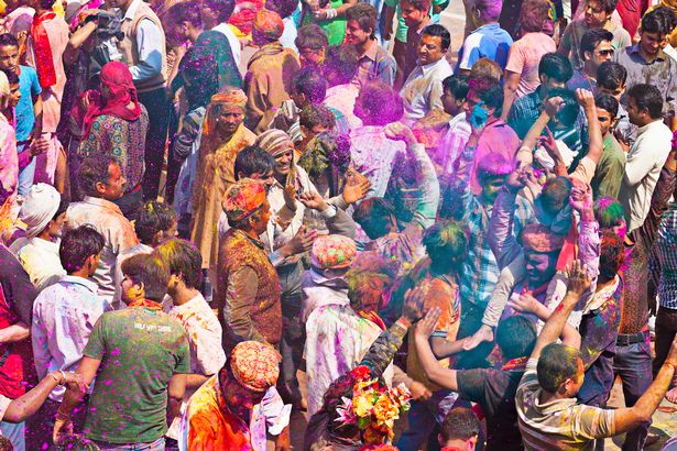 Indian people dancing in the Holi festivities