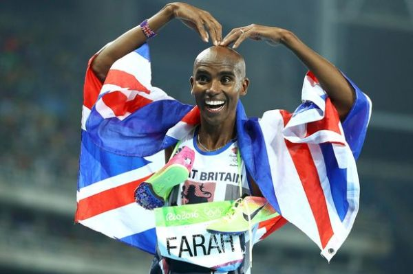 Mo Farah (GBR) of Britain poses winning the gold