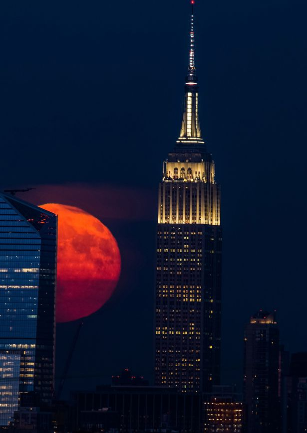 The Full sturgeon moon 18th August 2016 moving towards the Empire State Building
