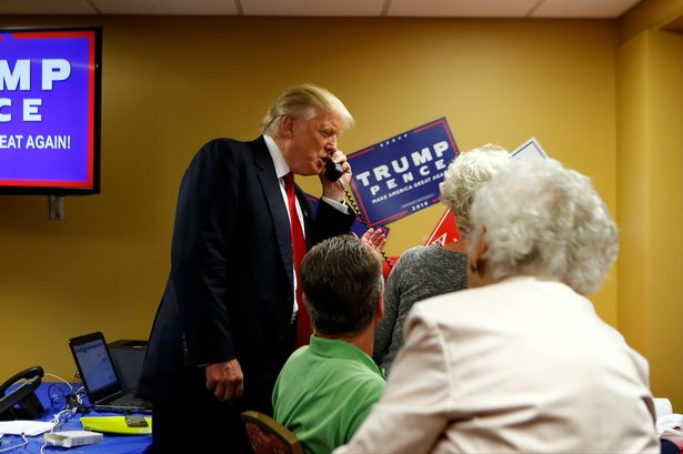 Republican presidential candidate Donald Trump speaks to a caller