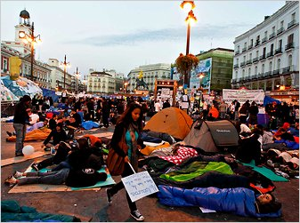 Protesters camped Saturday in Madrid's Puerta del Sol, a main downtown square, demanding judicial and electoral reforms.