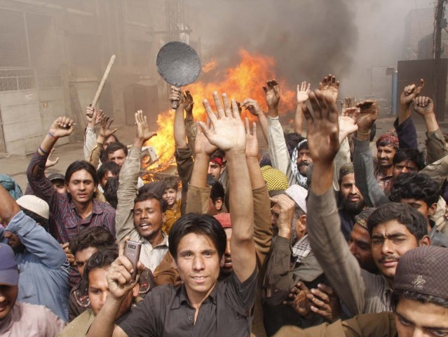 "The houses were burnt to ""take revenge of the blasphemy"" allegedly committed by a Christian two days earlier. PHOTO: ABID NAWAZ/ EXPRESS"