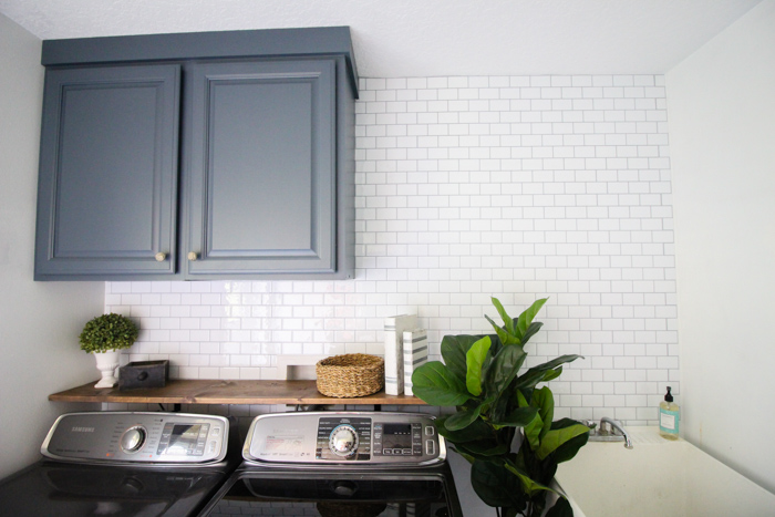subway tile accent wall in our laundry
