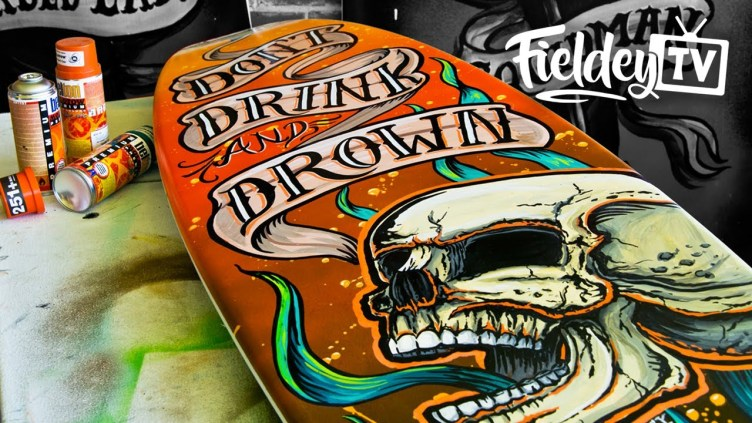 Painting a surfboard with a tattoo-style screaming skull ...