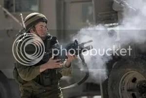 Israeli soldier fires tear gas