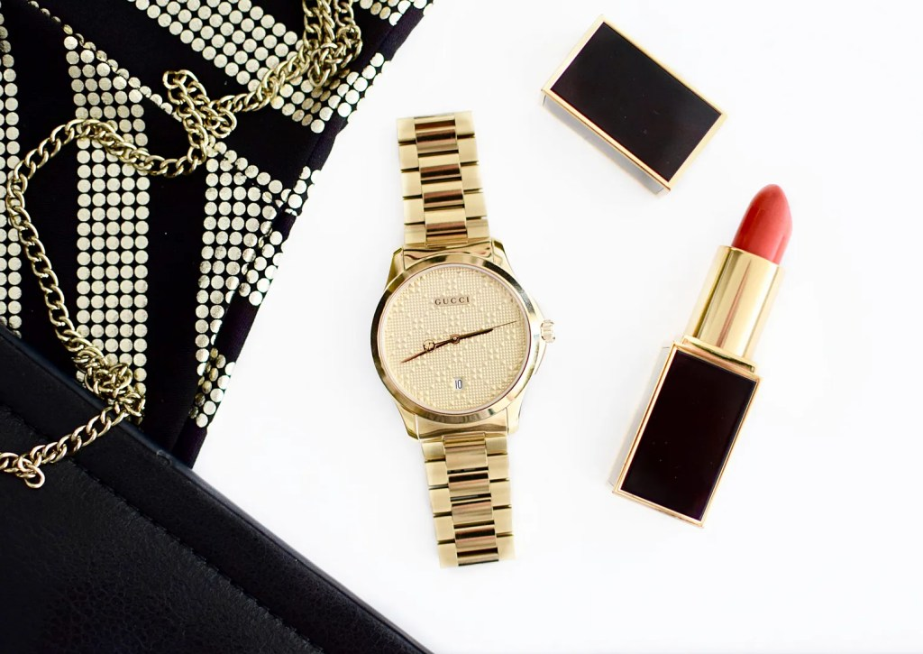 Gucci watch with gold bracelet