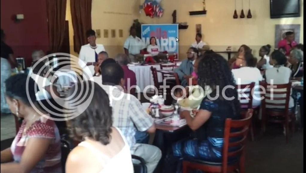 Ella Ward Addressing Attendees at Restaurant Event