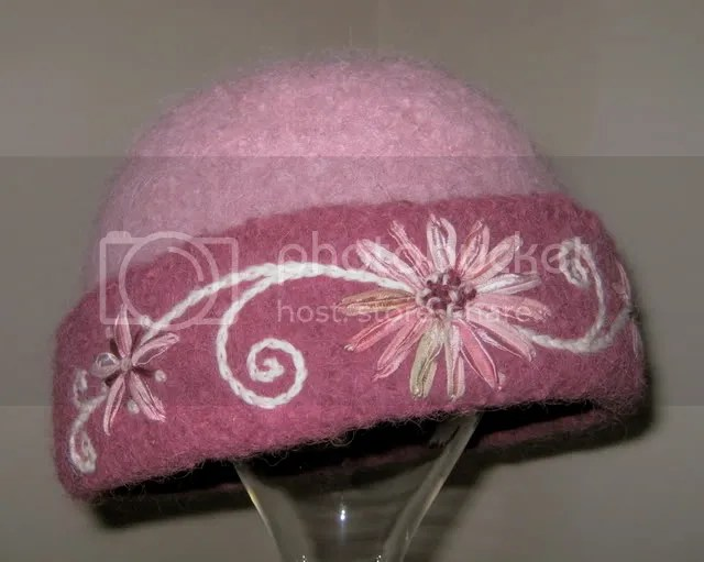 Knitted felt hat #175 of 2007 by felt fiber artist, Carrie Cahill Mulligan of Canaan, New Hampshire.  Ribbon embroidery worked freehand.