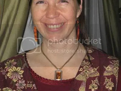 Knitted-felt fiber artist, Carrie Cahill Mulligan of Canaan, NH, rings in 2008 with new paper art earrings, by Melissa Lanitis Gregory, of Paper Moon Studio in Lake Tahoe, CA, as well as a silk with silver necklace by Jessica Sirois, of JLynne Designs in Damariscotta, ME.