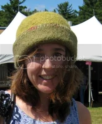 A happy hat customer, wearing the work of New Hampshire knitted felt fiber artist, Carrie Cahill Mulligan, at the 74th Annual League of New Hampshire Craftsmen's Fair at Sunapee Resort in Newbury, New Hampshire, August 2007.