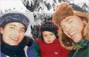Susan Houlihan, of Alpenglow Skincare, in Homer, Alaska, wears her custom-embroidered kntted felt hat by fiber artist, Carrie Cahill Mulligan.  Also pictured are son, Liam, and husband, Patrick.