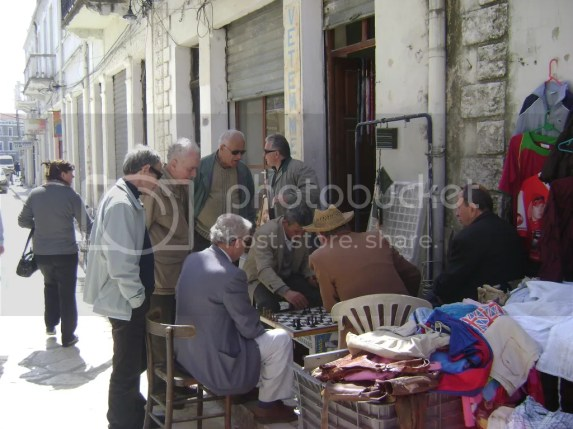 Old guys playing chess in the old part of the town