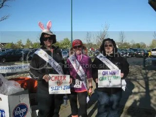 Cathy, me, and Jenn with our tribute sashes and signs to Davy Jones for the Bunny Hop 5K