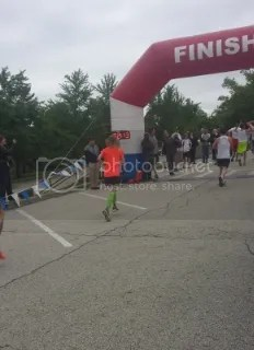 Me crossing the finish line of the Throo The Zoo 5K - Louisville, Kentucky (Thanks for the pic, Kelsie!)