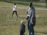 Grandpa getting a high five from his great grandson, Chace, at the Making Tracks for Celiacs 5K