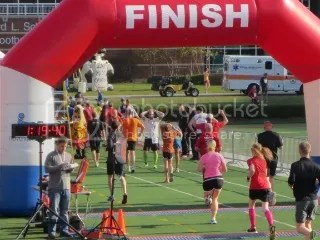 Me crossing the finish line of the Papa John's 10 Miler - Cardinal Stadium, Louisville, Kentucky