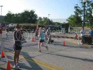 Me crossing the finish line of the Grand Slam 4 Miler – Louisville, Kentucky